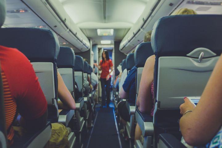 woman walking on plane